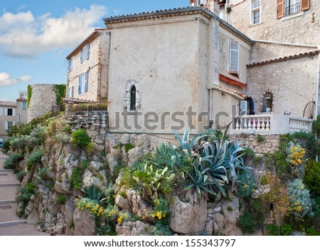 The medieval scenic house located in the small town of Antibes, between Cannes and Nice,, France. - stock photo