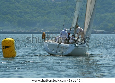 The men work with navigation of a yacht during race. Sailing it is sports for the valid men! - stock photo