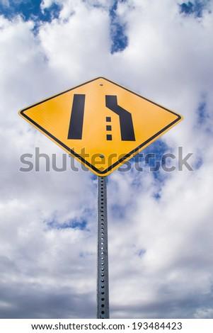 The merge left sign. - stock photo