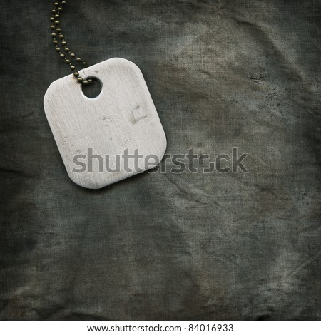The metal label on the background fabric - stock photo