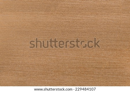The metal surface in the gold tones in the background - stock photo