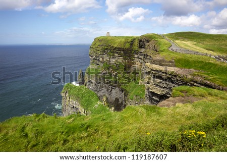 The 214-metre high Cliffs of Moher in County Clare are Ireland's most visited natural attraction. - stock photo
