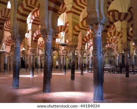 The Mezquita is a Roman Catholic cathedral in C?rdoba, Spain. Later it became the second-largest mosque in the world. It is an Unesco World Heritage site. - stock photo
