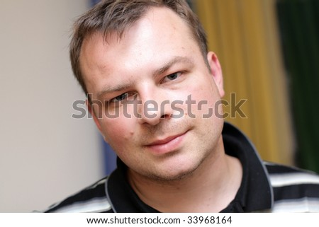 The mid adult man poses at home - stock photo