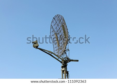 The military mobile radar station against the blue sky - stock photo