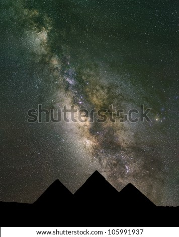 The Milky Way rises over the Pyramids in Egypt. Image large enough to crop horizontally. - stock photo