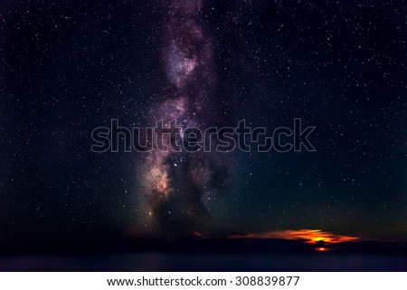 The Milky Way, rising out of the Mediterranean Sea, next to a setting Moon. - stock photo