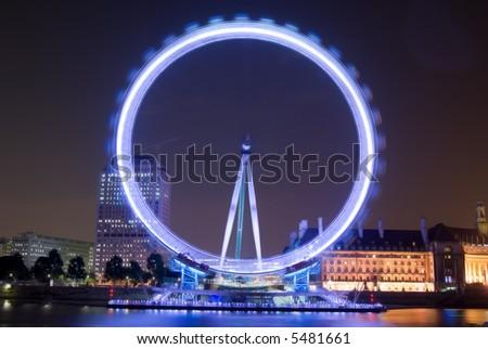 The millennium wheel at night in London - stock photo