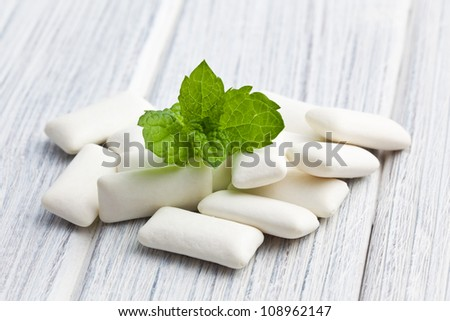 the mint leaves and the chewing gum - stock photo