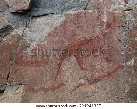 The Mishibizhiw or Great Lynx, along with canoes snakes, are part of the Agawa Rock Pictographs.  The site is found in Lake Superior Provincial Park, in Ontario, Canada.  - stock photo
