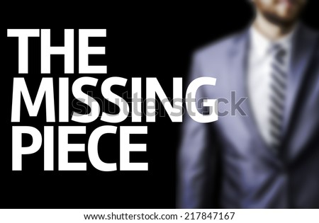 The Missing Piece written on a board with a business man on background - stock photo