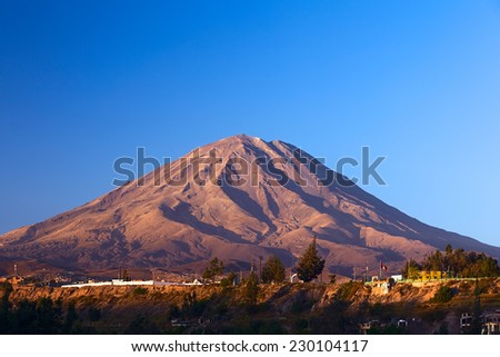 The Misti Volcano, which is a symbol of the closeby city of Arequipa in Southern Peru, lit by the evening sun  - stock photo