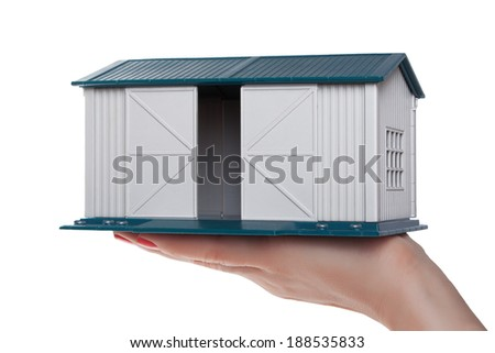 The model of the garage on the palm - stock photo