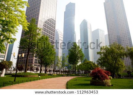 the modern building of the financial center in shanghai china. - stock photo