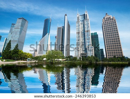 The modern city construction and the reflection on the water - stock photo