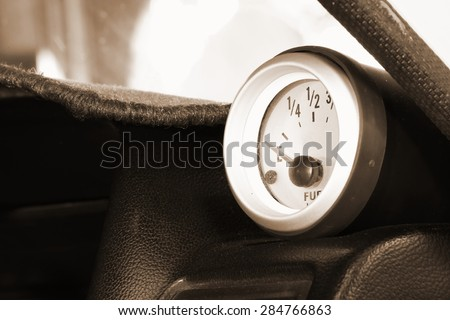The modern style of car fuel gauge on sepia tone represent the car part concept related idea. - stock photo