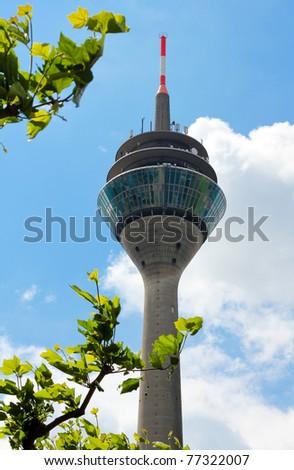 """The modern tower """"Rheinturm"""" of """"Düsseldorf"""" in Germany  . TV Tower in Medienhafen / Rhine Media harbour, Duesseldorf, Germany . - stock photo"""
