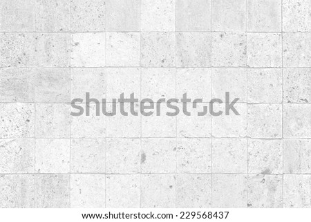 The modern white concrete tile wall background and texture - stock photo