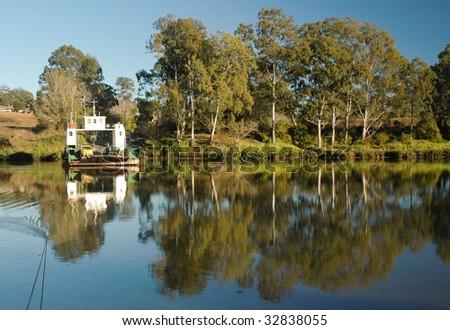 The Moggill Ferry crossing the Brisbane River - stock photo
