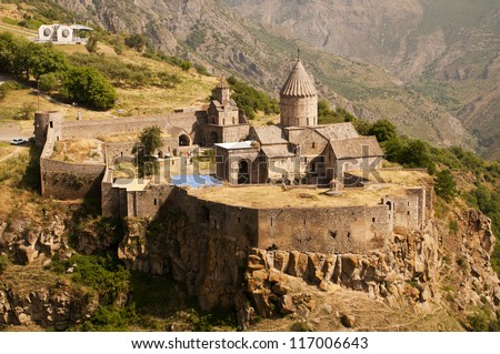 The Monastery of Tatev is a 9th century Armenian monastery located on a large basalt plateau near the Tatev village in Syunik Province. - stock photo