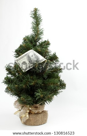 The money for the Christmas Tree on white background on Holiday - stock photo