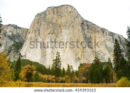 The monolith named El Capitan stands proudly over Yosemite Valley. - stock photo