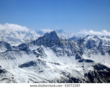 The Mont Blanc (Monte Bianco) massif, the highest mountain of Europe seen from the Italian side on a beautiful day - stock photo