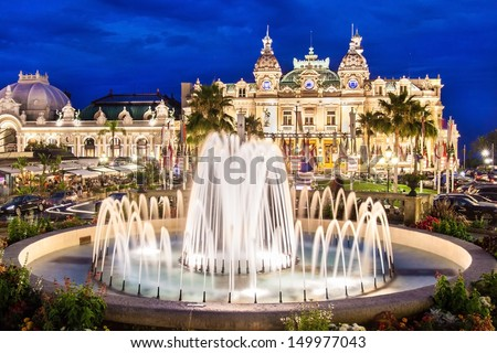 The Monte Carlo Casino is landmark in Monte Carlo, Monaco, Cote de Azul, France, Europe. It includes a casino, the Grand Theatre de Monte Carlo, and the office of Les Ballets de Monte Carlo. - stock photo