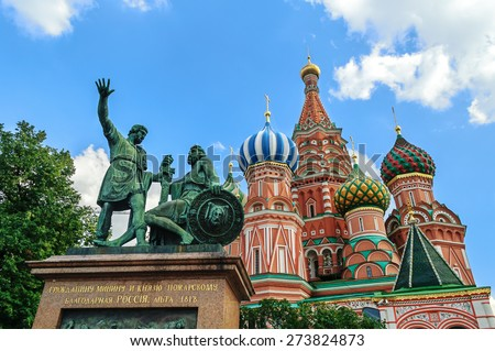 The monument to Minin and Pozharsky in front of St. Basil's Cathedral on the Red Square in Moscow - stock photo