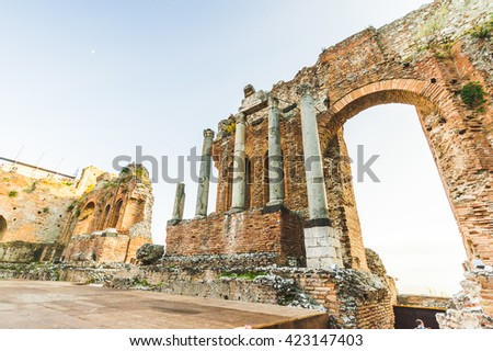 The monumental columns of the famous and beautiful ancient greek theatre ruins Taormina, Messina, Sicily, Italy - stock photo