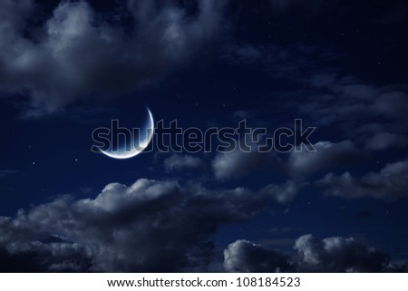 The moon in the night cloudy sky with stars - stock photo