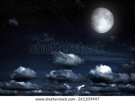 """The moon in the night sky in clouds """"Elements of this image furnished by NASA"""" - stock photo"""