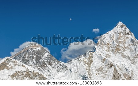 The Moon, Mt. Everest (8848 m), and Nuptse (7864 m) (view from Kala Patthar) - Nepal, Himalayas - stock photo