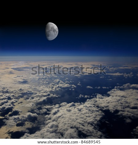 The Moon rises over planet Earth. - stock photo