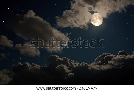 The moon shines in the star night sky among thunderclouds. - stock photo