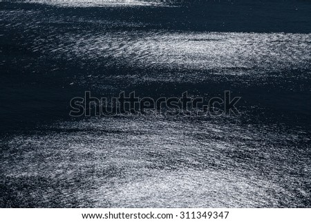The Moonlight gives a sparkle to the calm waters of the Mediterranean Sea - stock photo