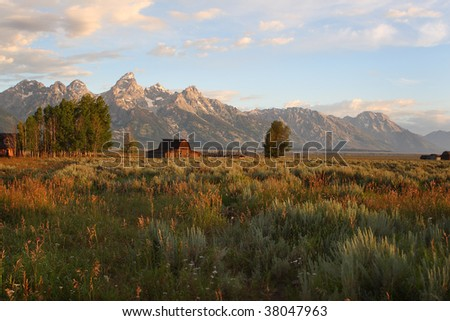 The Mormon barns below the beautiful Grand Tetons Mountain range - stock photo