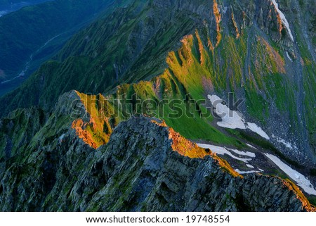The morning glow of the ridgeline - stock photo