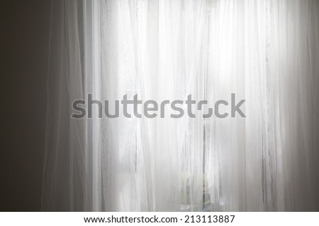 The Morning lights go through the lace curtains. - stock photo