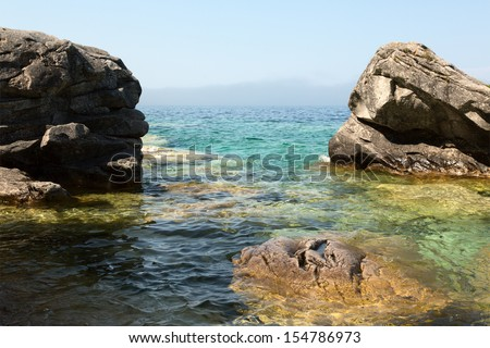 The morning mist lifting from the surface of Georgian Bay, Bruce Peninsula, Ontario, Canada - stock photo