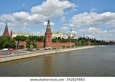 The Moscow Kremlin. The towers of the Kremlin and the Church domes on the background of blue sky. - stock photo