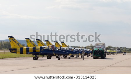 The Moscow region - August 28 2015: Aerobatic team Baltic Bees from Latvia on the L-39 planes refuel its aircraft fuel  August 28, 2015, Zhukovsky, Moscow Region, Russia - stock photo