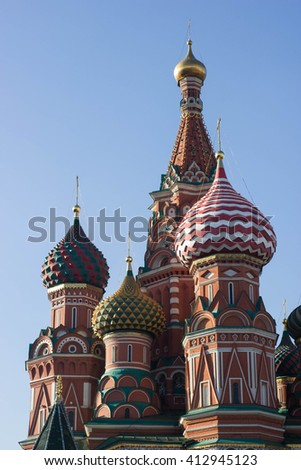 The most famous architectural place for visiting and attraction in Moscow, Russia, Saint Basil's cathedral with colorful cupolas and spectacular domes in traditional culture on blue sky - stock photo