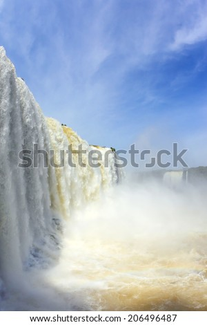 The most high-water waterfall in the world - Iguazu. White whipped foam of water and a thin mist over the water. Photo taken by lens Fisheye - stock photo