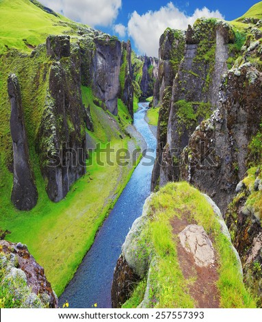 The most picturesque canyon Fjadrargljufur  and the shallow creek, which flows along the bottom of the canyon. Fantastic country Iceland - stock photo