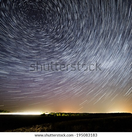 The motion of stars around Pole Star in the night city  - stock photo