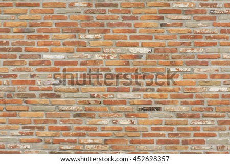 The mottled red brick wall texture - stock photo