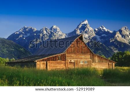 The Moulton Barn and the Teton Mountain Range in Grand Teton National Park, Wyoming. - stock photo
