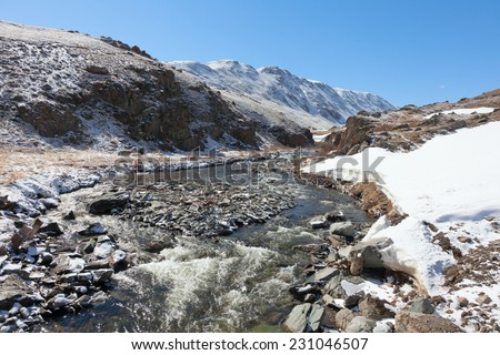 The mountain river in the steppe - stock photo
