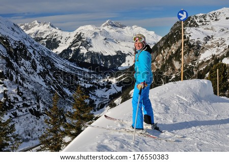 the mountain skier on a slope of the Alps - stock photo